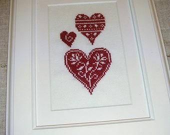 Three Deep Red Hearts Cross Stitch Framed