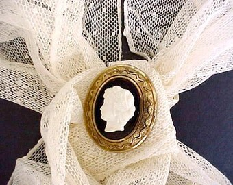 """Pretty Vintage Metal and Celluloid Cameo Brooch Signed """"Coro"""""""