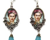Frida Kahlo cameo chandelier earrings in floral silver plate setting with blue lucite trumpet and blue drop bead