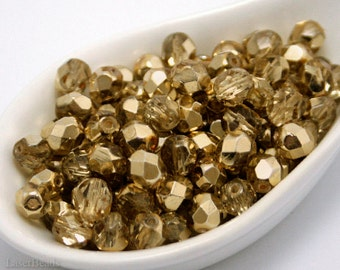 Gold beads. 6mm faceted Czech glass. 35pc fire polished round beads.