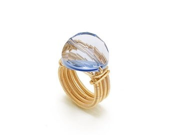 Goldfeild ring 14 k wire with  18 m SWAROVSKI VIOLET stone