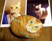 Custom pet portrait painted on the rock.