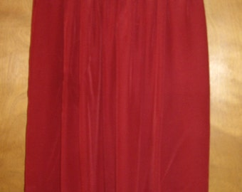Red silk skirt.