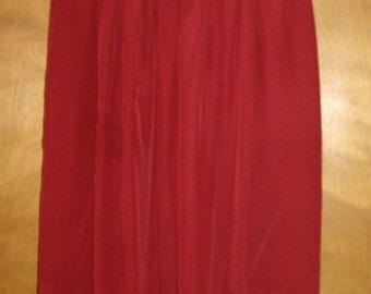 Red silk skirt.