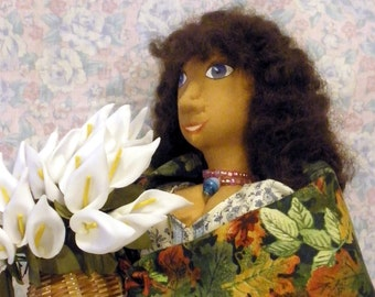 Beatrice is an 18 inch cloth textile doll of woman holding a basket of calla lily flowers