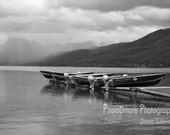 Boats on a Dock, Glacier Nat'l Park. Black and white photo of boats by a dock in Glacier Nat'l Park