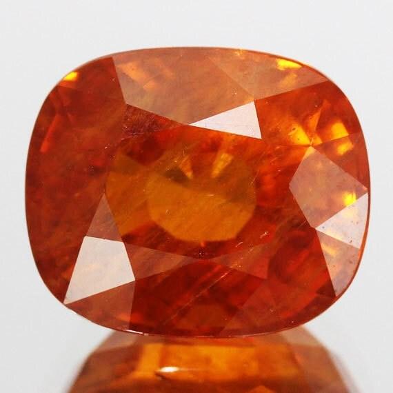 orange sapphire gemstone cushion by