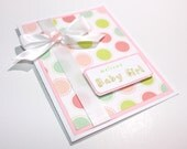 Welcome baby girl card, in white and pink, button ribbon embellished
