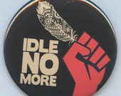 Idle No More Fist an Feather button