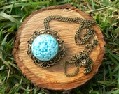 Turquoise Porcelain Pendant  and antique bronze metal. 1'57 in. diameter and 27.55 in. long overall