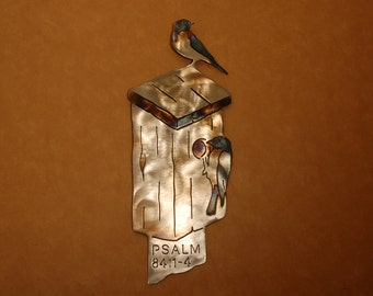 Metal wall sculpture of birdhouse with bluebirds