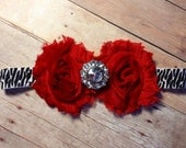 Red shabby flowers with a rhinestone bling center on a zebra stretch headband- Newborn to adult