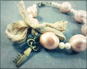Shabby chic pink pearl bracelet. Sari silk and antiqued brass.