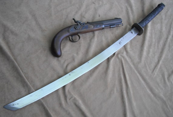 Hand forged zombie sword with sheath: Hand forged in Canada