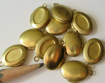 50 oval brass lockets with recess