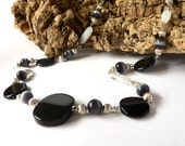 Black and white statement necklace handmade with black resin and white glass beads. ooak made in Italy.