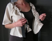 Beige short jacket woman and black bow, 3/4 sleeves. 5011
