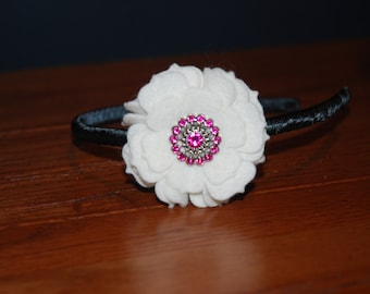 White Felt Flower Headband on top of a Black Satin Ribbon Wrapped Plastic Headband with Bling Centers