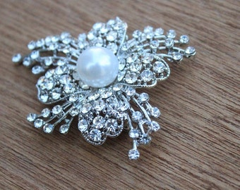 Beautiful silver color brooch with sparkling rhinestones and white  color   pearls