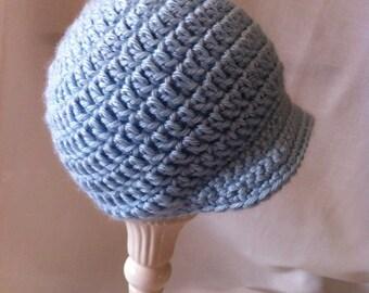 Baby Crochet Newsboy Hat.  Blue acrylic yarn.  Tan and Brown also shown