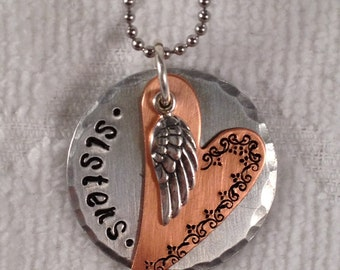 Hand stamped Sister necklace with angel wing