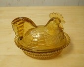 Millville NJ Wheaton glass. Amber glass.  Rooster Hen covered dish.