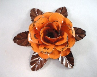 Large Size Decorative Metal Hand Cut and Hand Painted Rustic Orange Rose Mounted on a Bed of Metal Leaves.