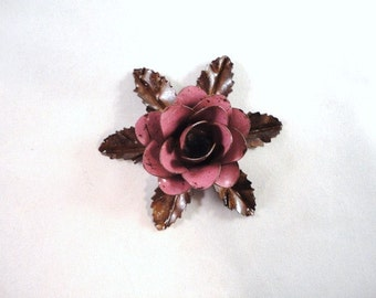 Small Size Decorative Metal Hand Cut and Hand Painted Rustic Pink Rose Mounted on a Bed of Metal Leaves.