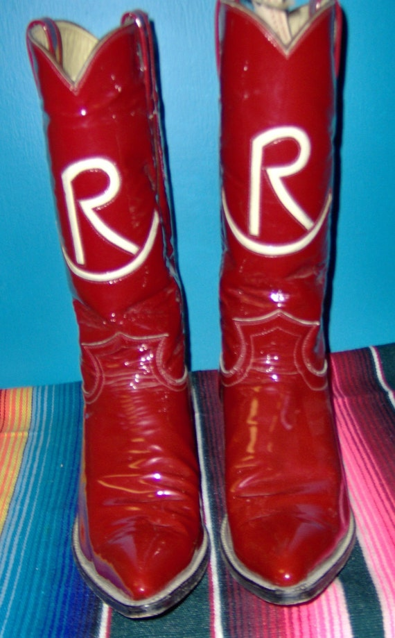 Red Champion custom cowboy boots with inlayed rocking R