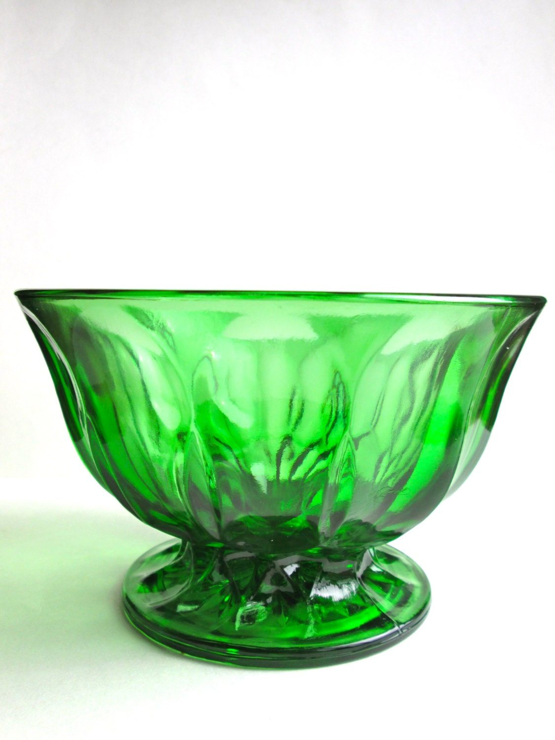 Footed Glass Bowl Pretty and sophisticated footed bowl is great for serving fruits, puddings, dips and more. Designed in a modern, streamlined look with mouth-blown glass in Poland.