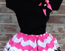 Black bodysuit with double layered skirt and matching headband