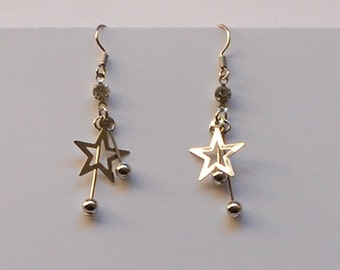 Star and droplets design earring made of silver metal plus a tiny shiny stone