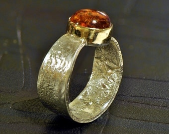 Reticulated silver ring with amber cabochon