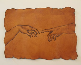 Handcrafted Leather Patch Detail of Michelangelo's The Creation of Adam.