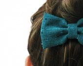 Fancy GREEN BOW on a metal hair clip. Perfect for under a hair bun or for a nice ponytail