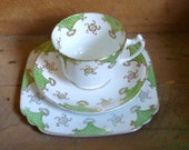 green and white antique china trio