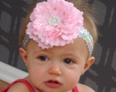 Baby girl pink flower with silver sequins headband and beautiful rhinestone center.