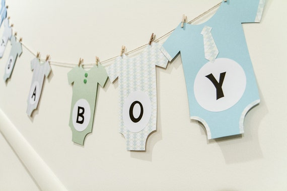 baby shower banner onesies on a clothesline by festivapartydesign