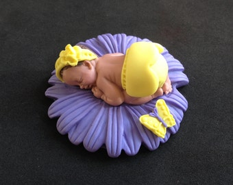 Fondant baby girl purple/yellow daisy cake topper