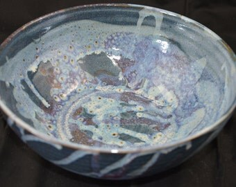 "9""  blue bowl with a hint of red and purple"