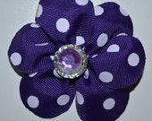 Purple and White polka Dot Flower bow with purple and silver stone