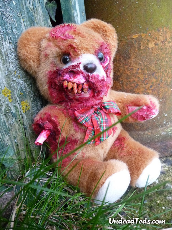 Sitting UnDead Ted with eaten-away face exposing jaw & teeth and torn-off arm.