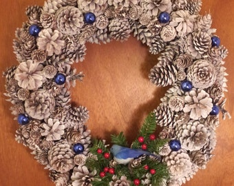Frosty Pine Cone Wreath with a shy Bluebird