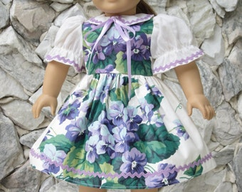 """White and violet print cotton dress for an 18"""" doll."""