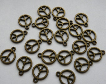 10 Antique Bronze Peace Charms
