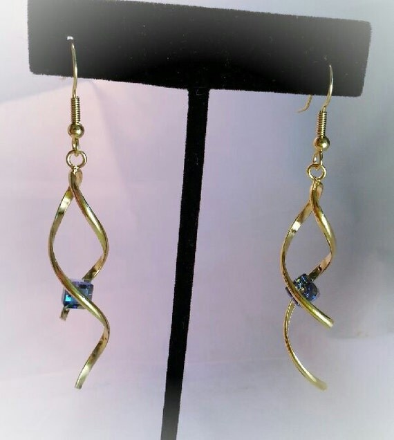 Gorgeous and unique golden twisted dangle earrings with your color crystal accent