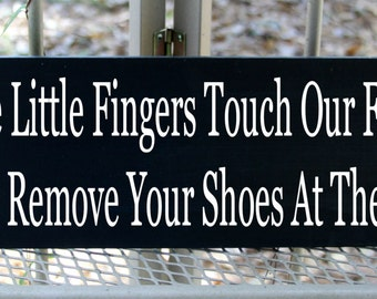 Since little fingers touch our floor please remove your shoes at the door wood sign
