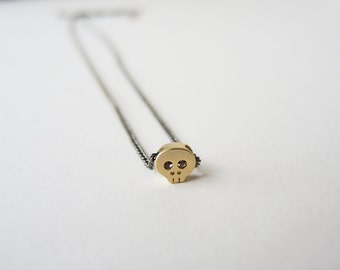 Tiny Skull necklace in Gold - gunmetal