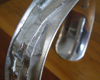 Silver anticlastic bracelet or bangle