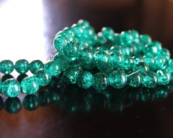 80 approx. teal 10 mm crackle glass beads, 1.5 mm hole, round